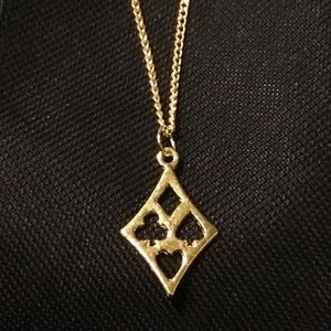 Jewelry - Gold-tone Hollow Suit Pendant Necklace